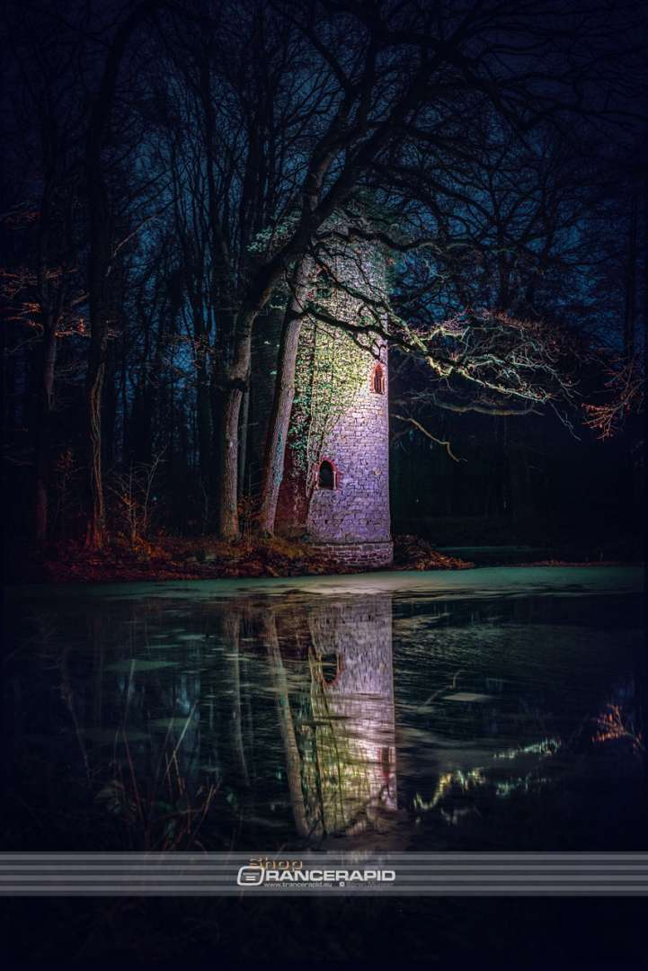 Mystic image on the tower of the manor Osthoff at night in portrait format.