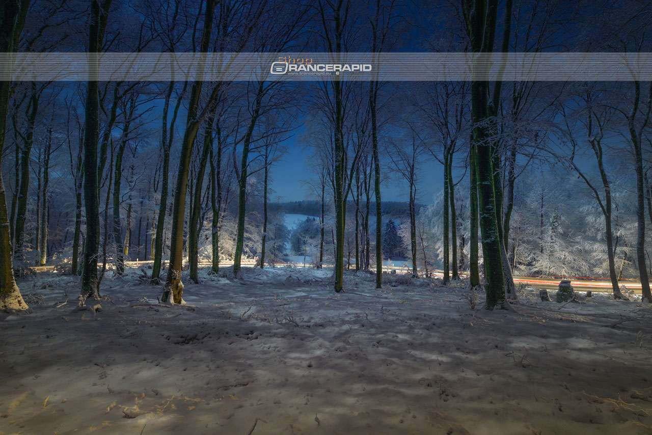 The Teutoburg forest at night covered with snow, recreational area in Lower Saxony near Osnabrück.